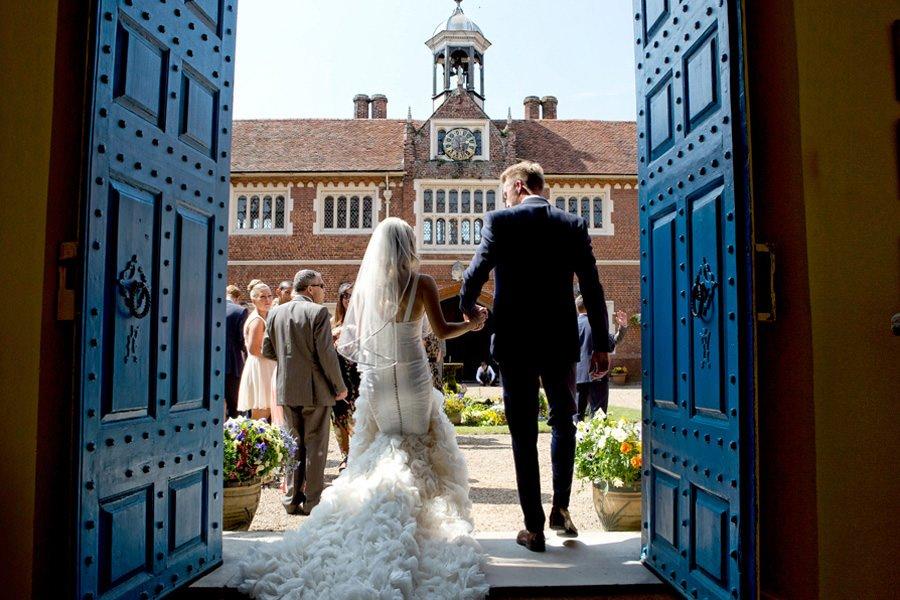 Gosfield Hall wedding photographer Jasmine Jade photographs Tonya & Lee as the go into the courtyard