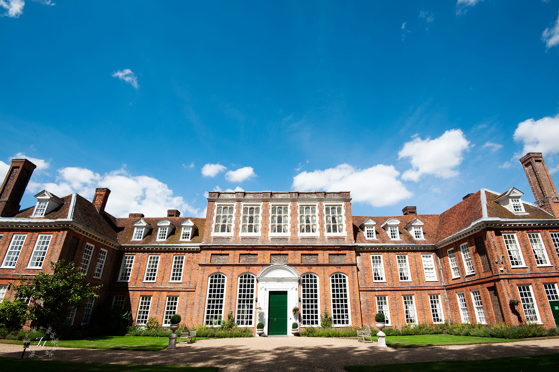 the_main_entrance_to_gosfield_hall_by_foot. Green_Door_and red_brick_building