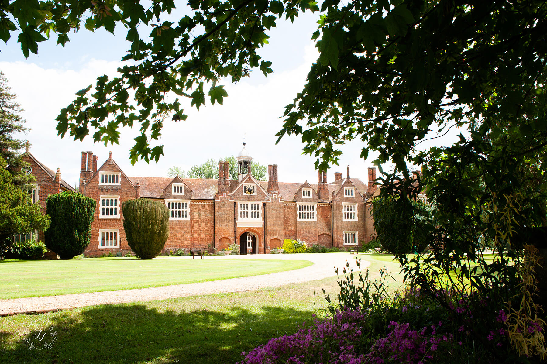 the clock tower entrance and main driveway to Gosfield Hall
