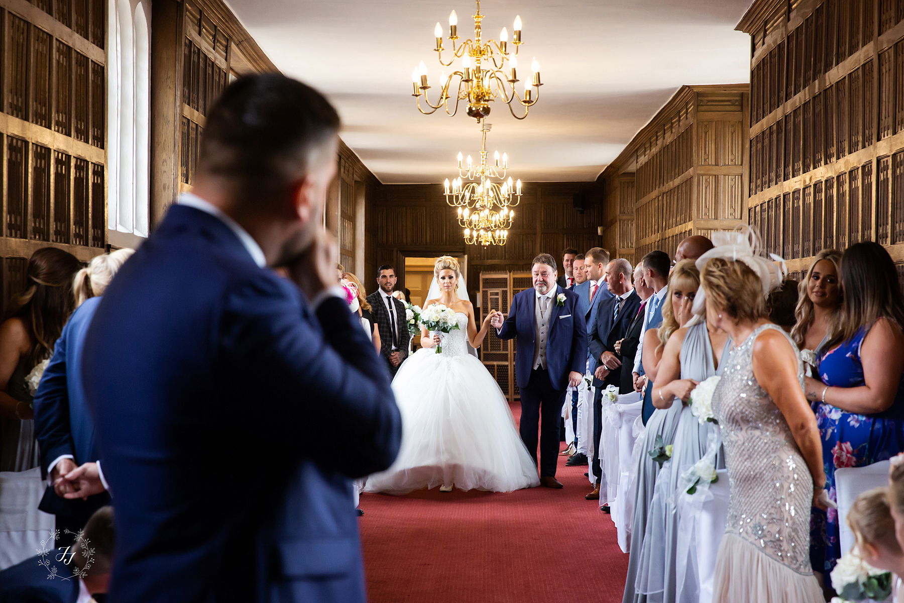 Mrs Hinch walking down the isle in the queens gallery at Gosfield Hall