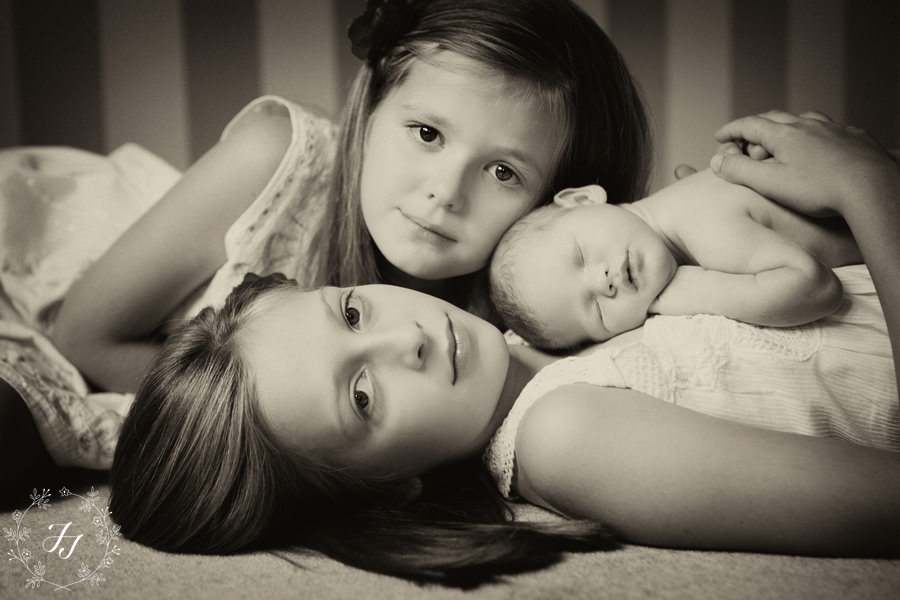 Newborn baby and her sisters