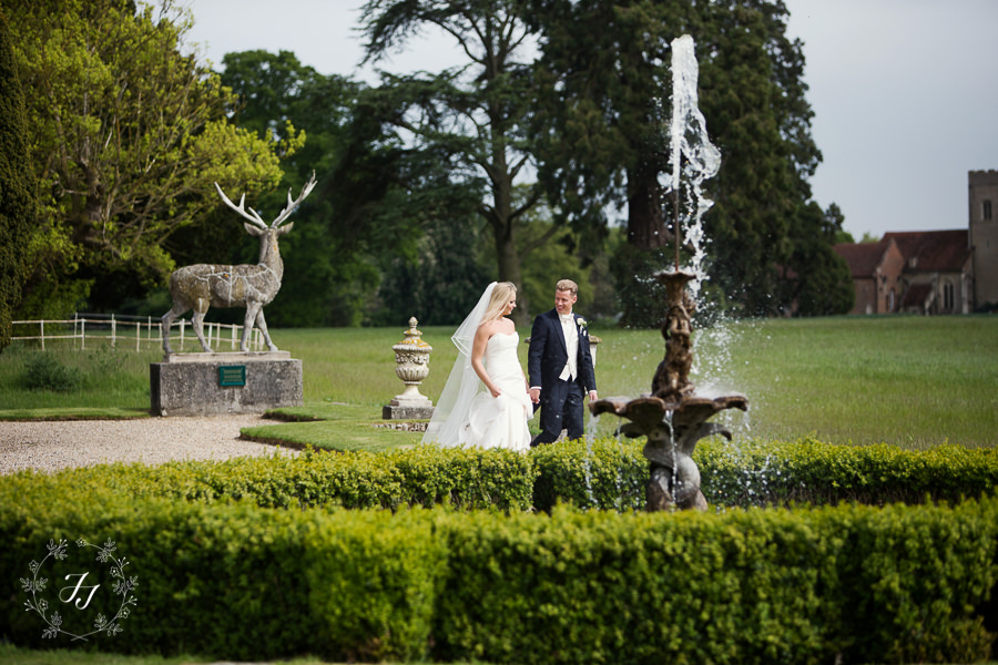 Davina and mikes Gosfield Hall wedding - water fountain at Gosfield Hall with stag in background