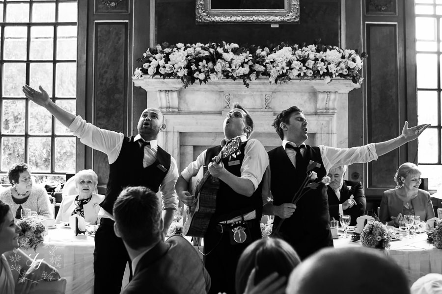 singing waiters in action