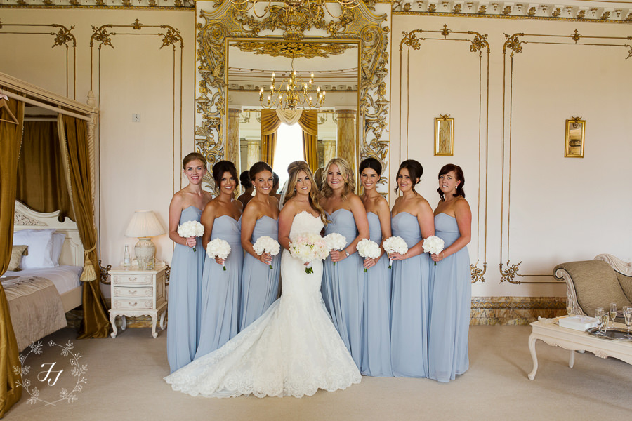 pale blue bridesmaids with white bouquets
