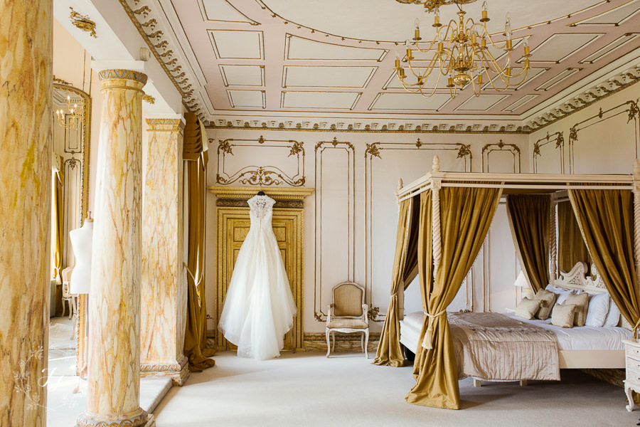 Bridal suite of Gosfield Hall with dress hanging on door