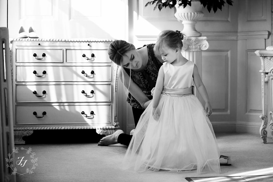 flower girl getting ready at Gosfield Hall