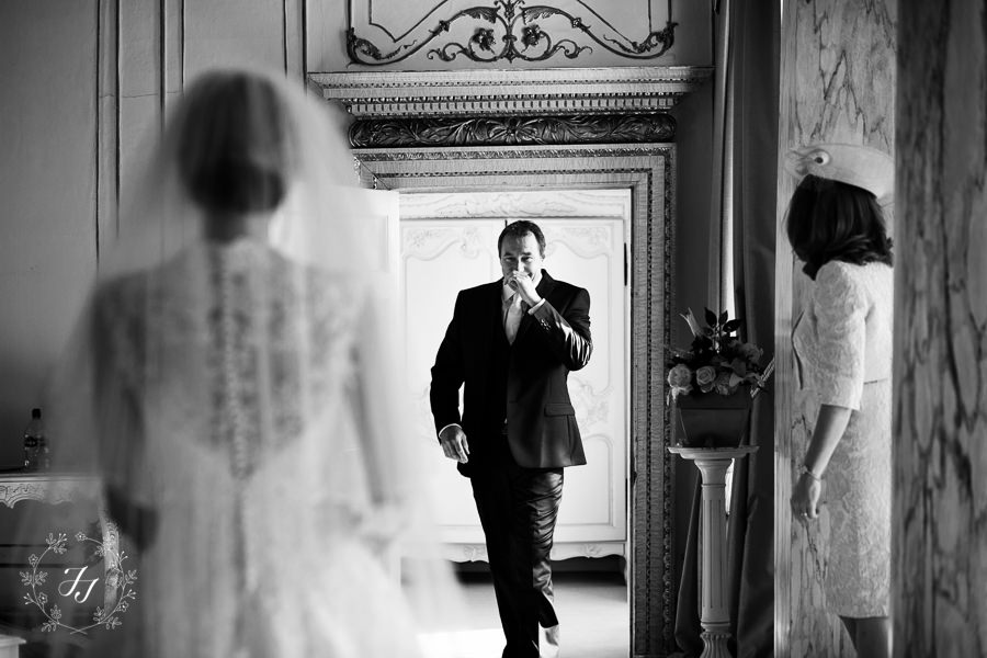 Father of the bride seeing bride for first time at autumn wedding at Gosfield Hall