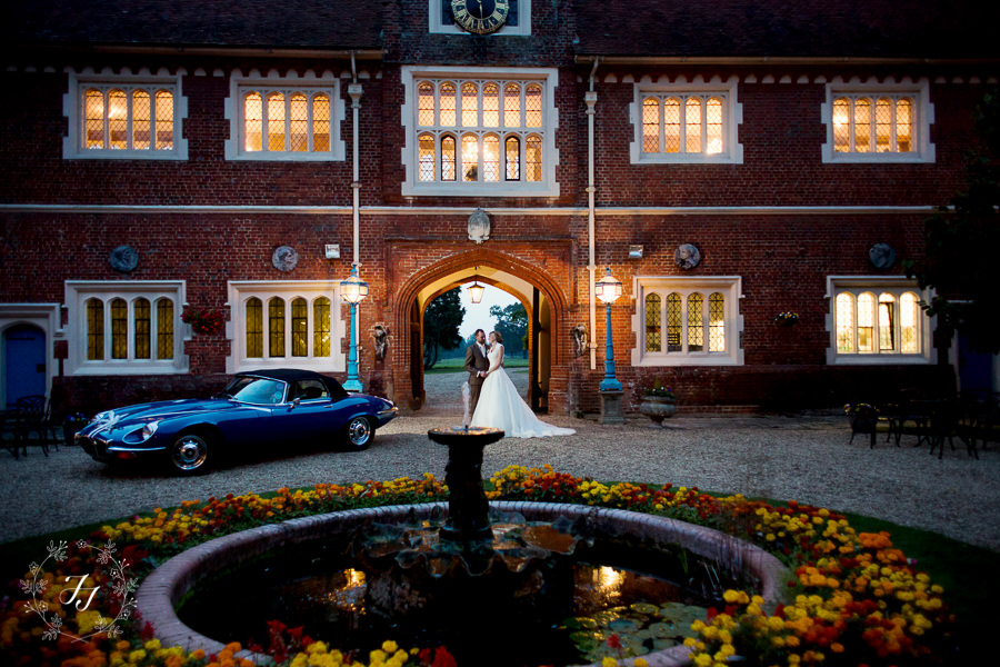 dusk shot in courtyard at Gosfield Hall for an autumn wedding