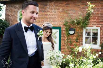 Classic photograph of wedding Black tux and white dress