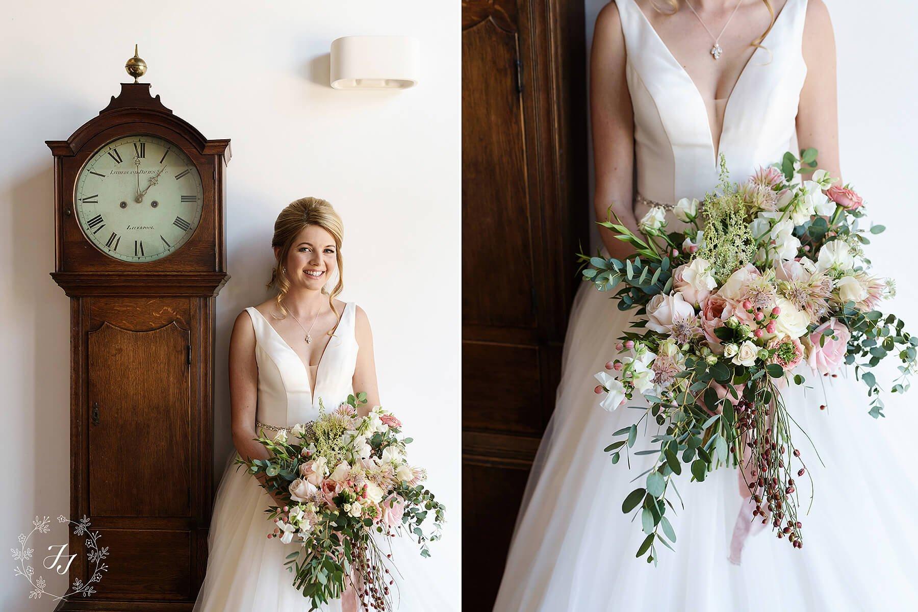 bride wearing stellayork wedding dress holding rustic wedding bouquet