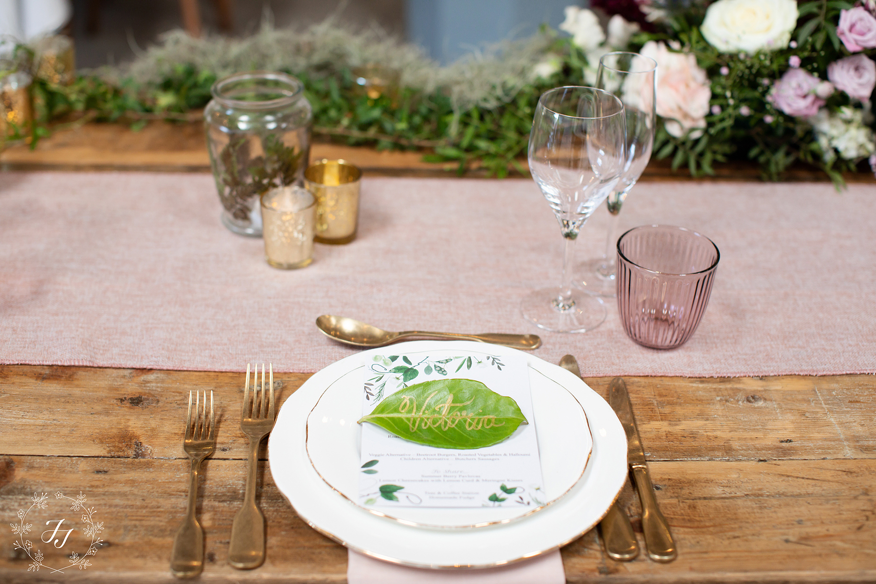 rustic table wedding placement with leaf and gold cutlery