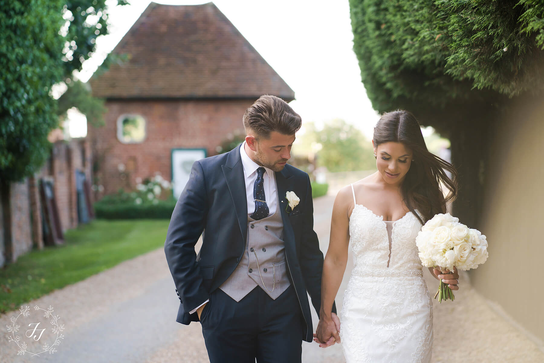 Samantha & Cameron's wedding photograph of them in front of the apple loft at Gaynes Park