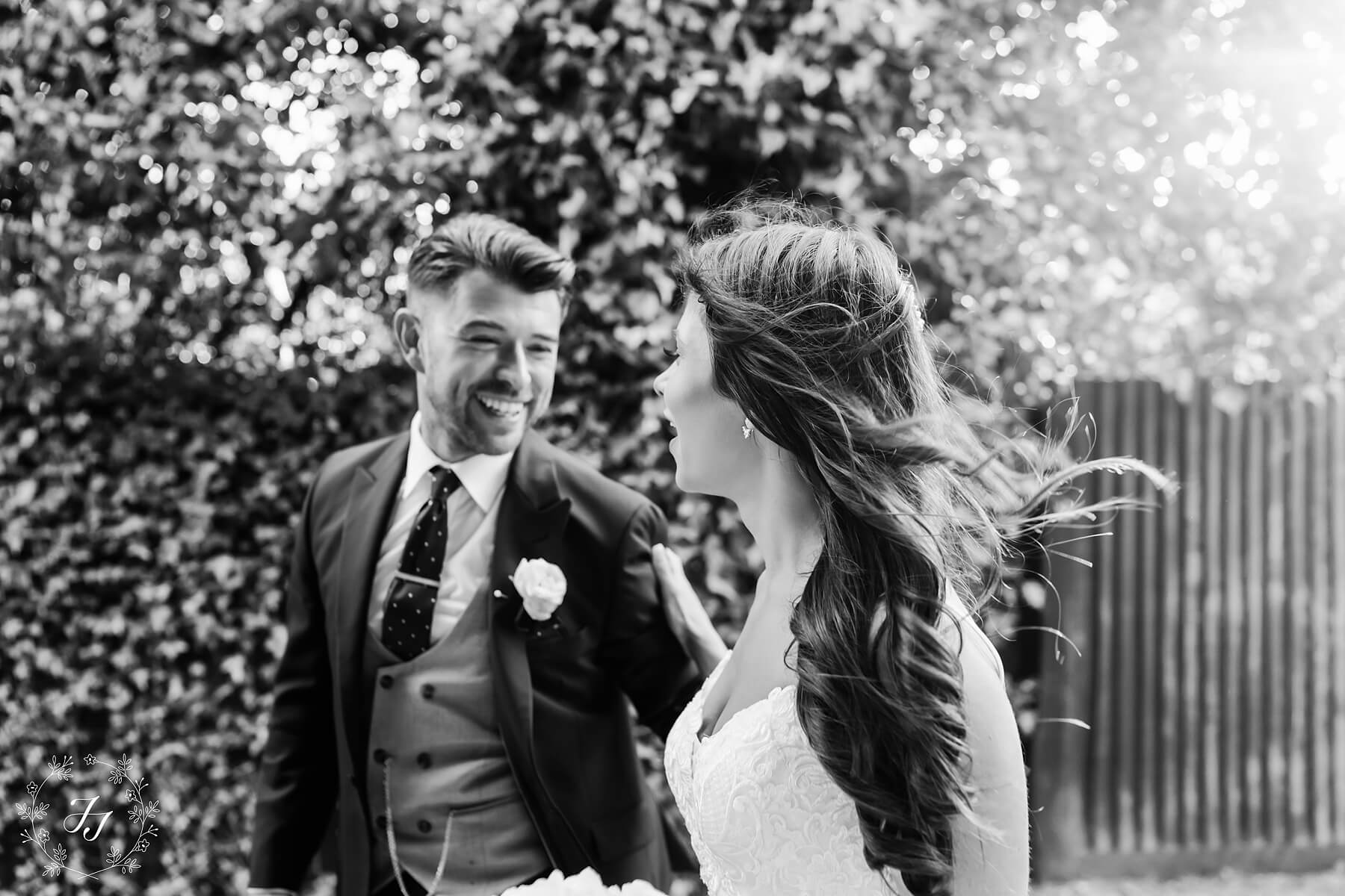 samantha & Cameron's wedding photograph of them laughing in black and white
