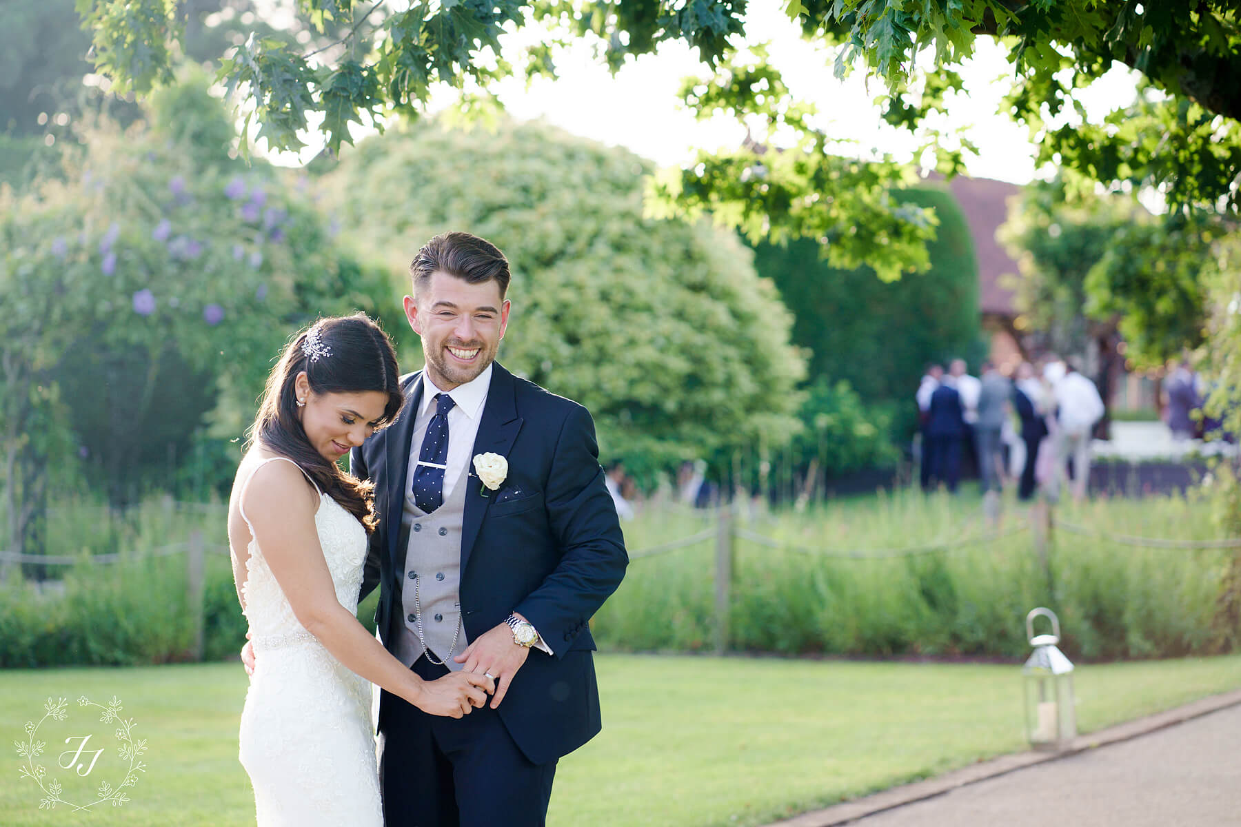 Natural photograph of Samantha and Cameron in the walled garden at Gaynes Park