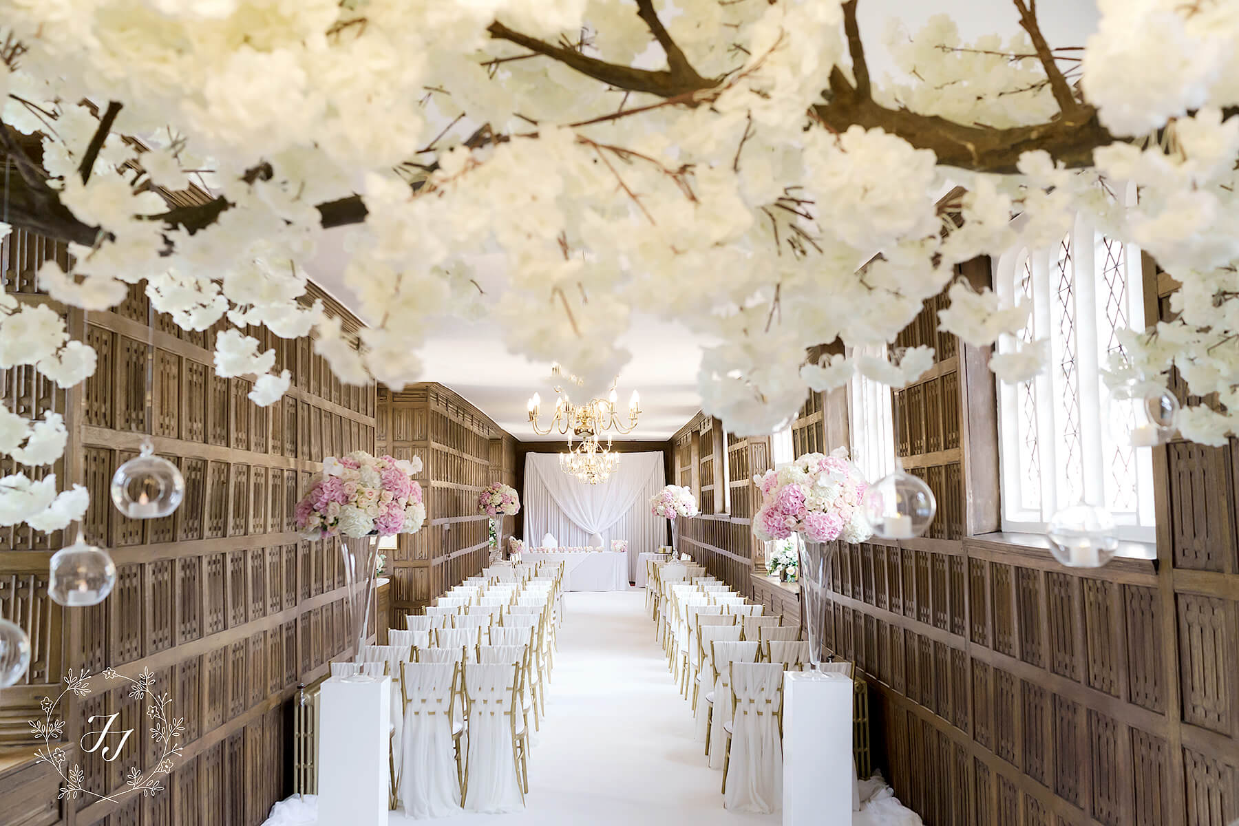 Ceremony at Gosfield Hall styled by J f styling with blossom trees