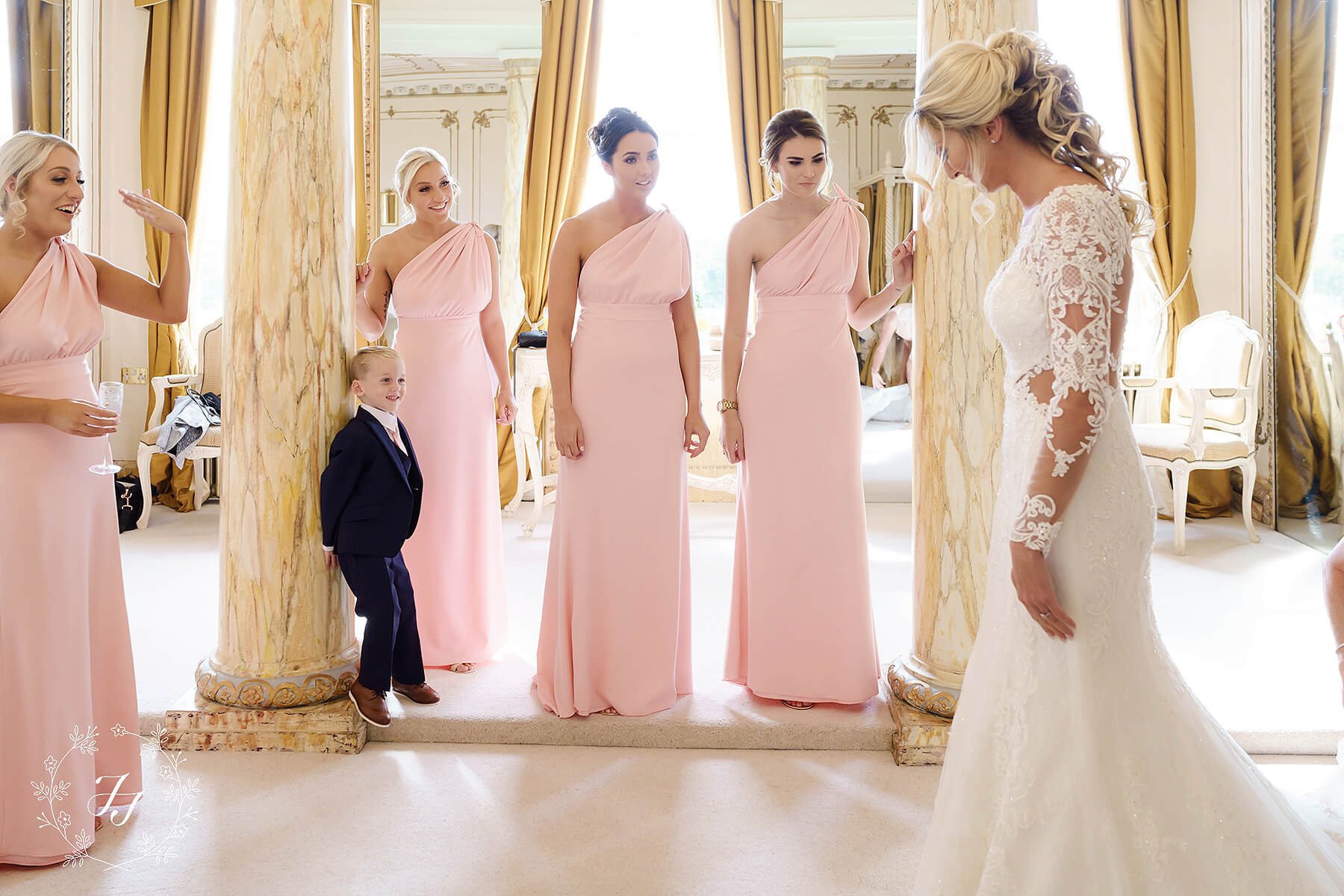 blush pink bridesmaids at Gosfield Hall during Megan and Connor's wedding