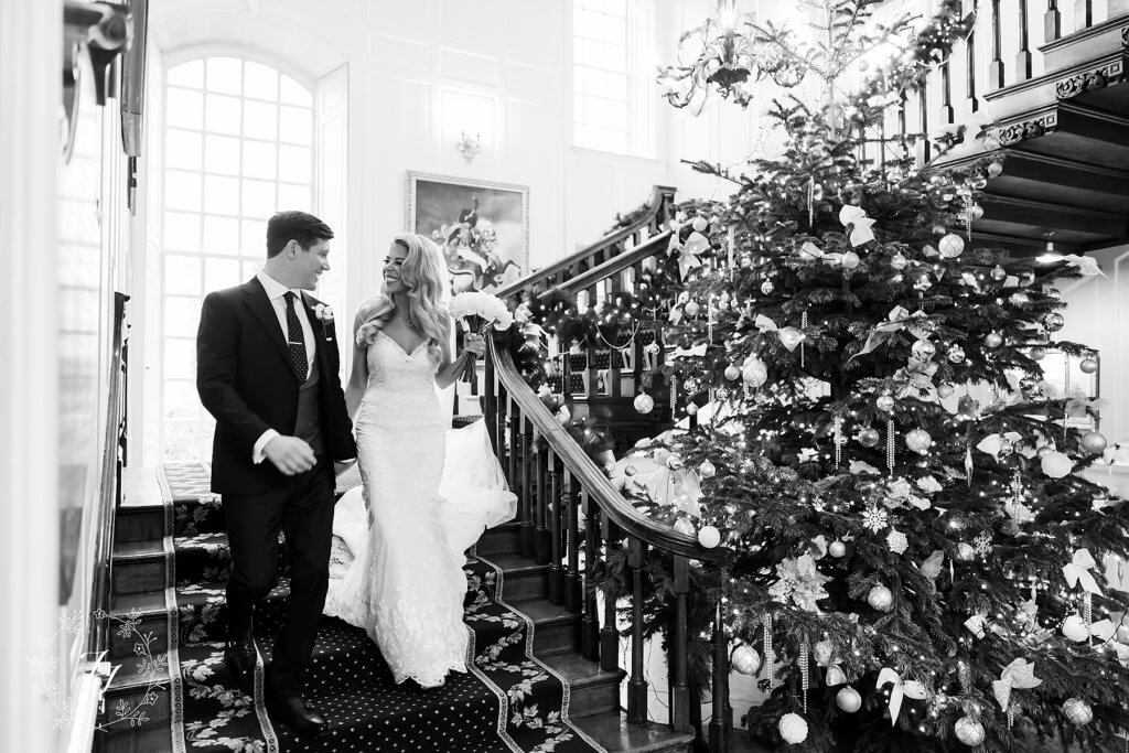 Christmas wedding at Gosfield Hall with Christmas tree and staircase