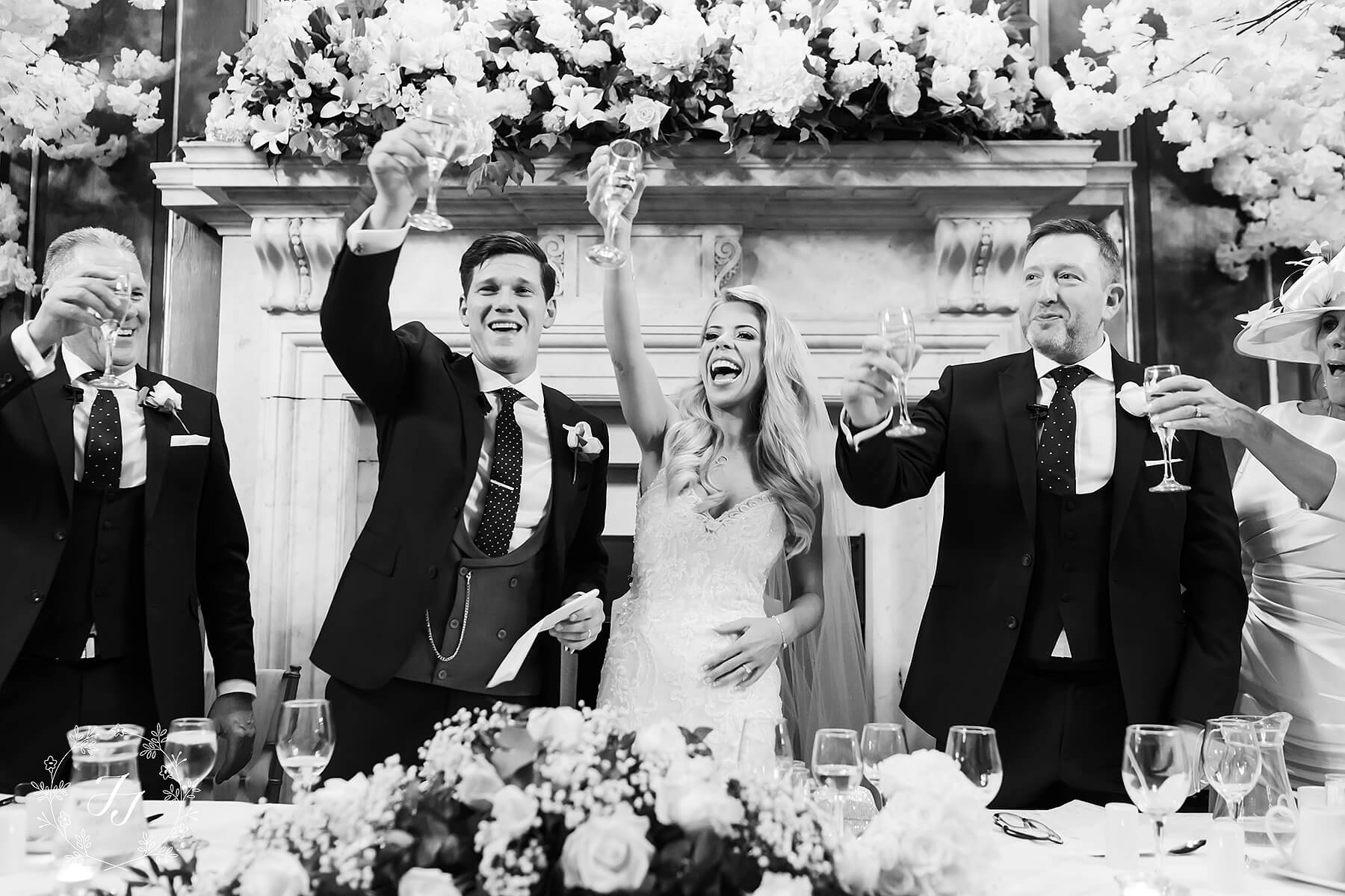 speeches at Gosfield Hall ballroom decorated by jf styling the bride and groom cheer